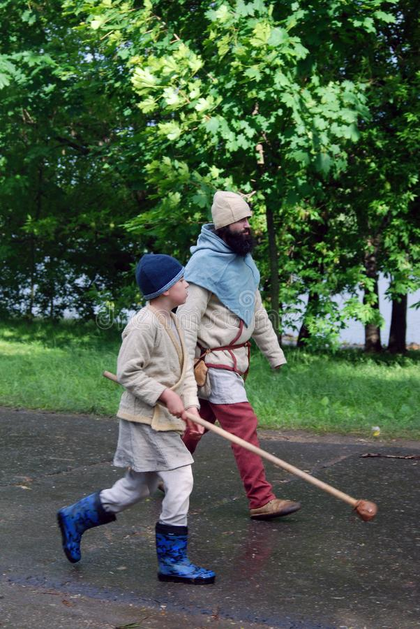 Reenactors walk on the street. They paritcipate in historical festival Times and Ages. Place: Kolomenskoye park, Moscow. Date: June 12, 2016 stock photo
