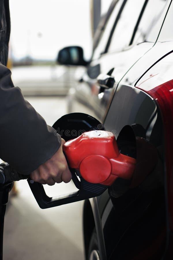 Reenchendo a gasolina imagem de stock