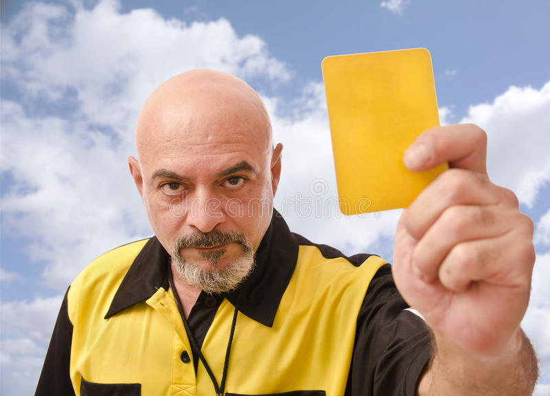 Ref and blue sky. Senior referee image showing card at the view royalty free stock photos