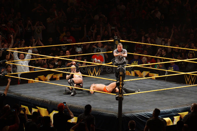 Ref points with both hands after NXT male wrestler Finn Balor be. SAN JOSE - MARCH 27: Ref points with both hands after NXT male wrestler Finn Balor beats Adrian stock photos
