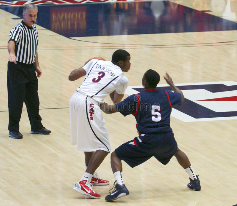 A Ref Whistles a Foul. In a University of Arizona Wildcats Men's Basketball Game Against the Robert Morris Colonials at McKale Center, Tucson, on December 22 royalty free stock images