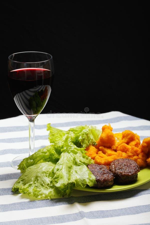 Refeição com vidro do vinho imagens de stock