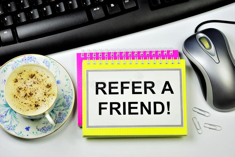 Refer a friend-the inscription on the Notepad. An invitation to cooperate. Join forces, and participate in a common cause stock image