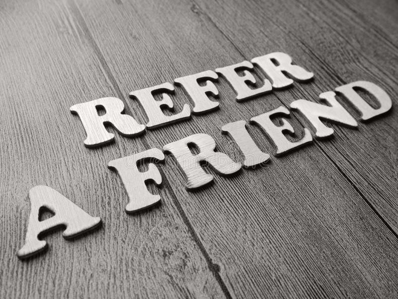 Refer a Friend Words Typography Concept stock images