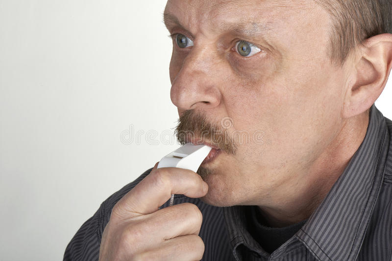 Download Referee blowing a whistle stock image. Image of light - 37484293
