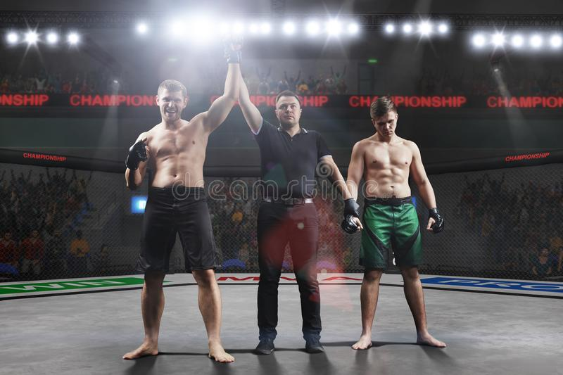 Referee is declairing the winner after the mma fight. In big mma arena royalty free stock photo