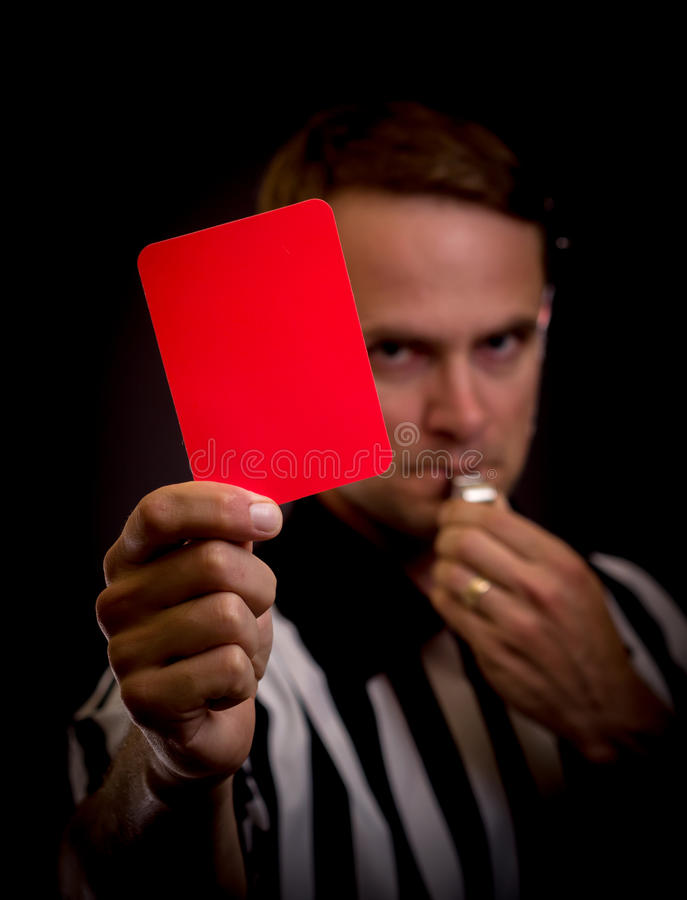 Referee foul. Referee holding red card for foul concept stock image
