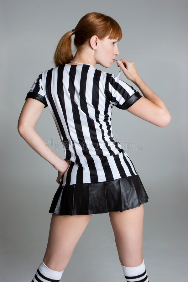 Referee Girl. Blowing whistle royalty free stock photography