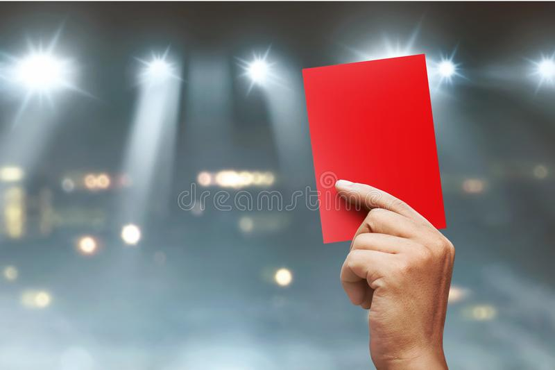 Referee hands showing red card royalty free stock photos