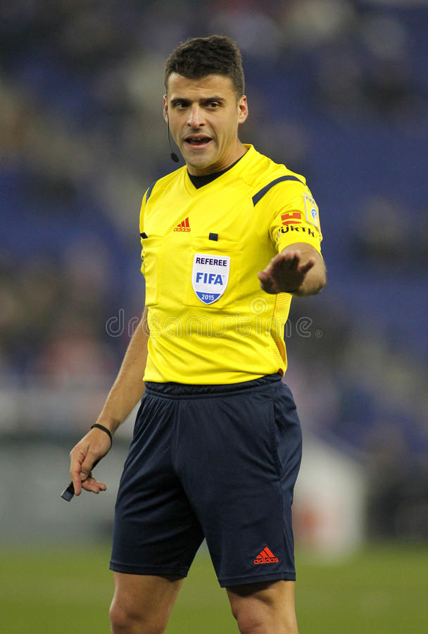 Referee Jesus Gil Manzano. Declaring a foul during a Spanish League match between Espanyol and Sevilla FC at the Estadi Cornella on January 22, 2015 in stock images