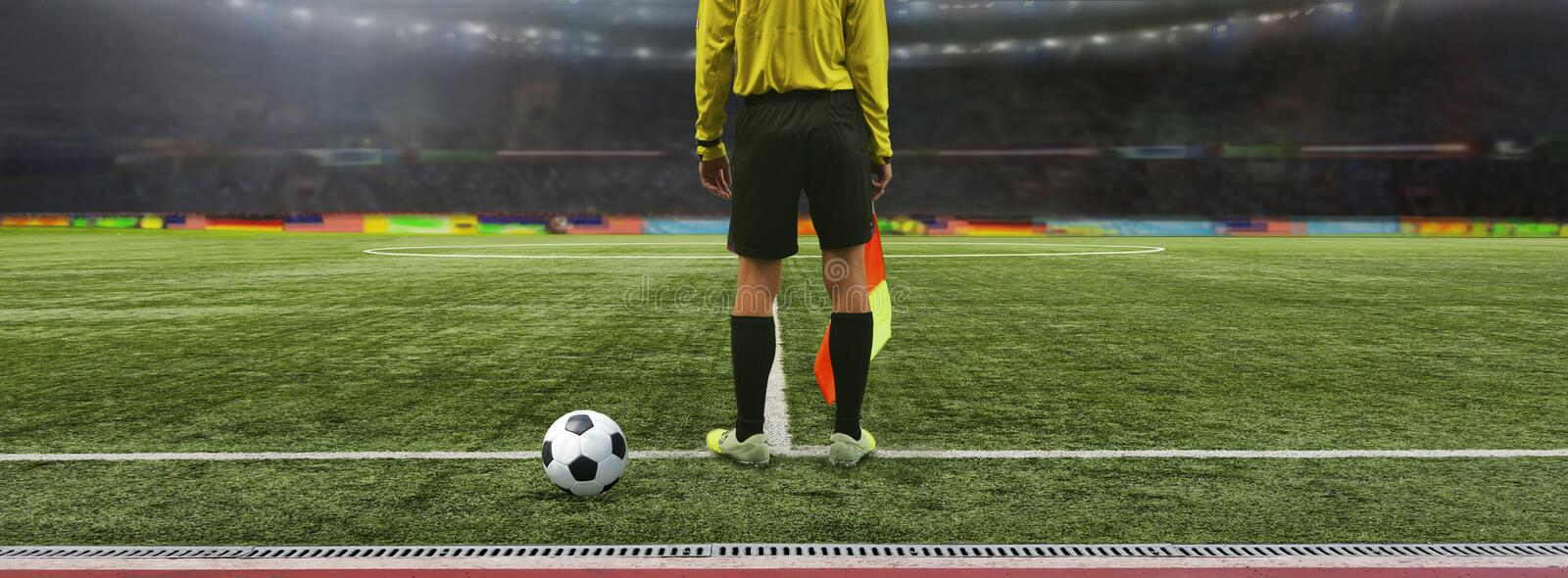 The referee soccer game. Stands on the field before the game, ready to blow the whistle royalty free stock photos