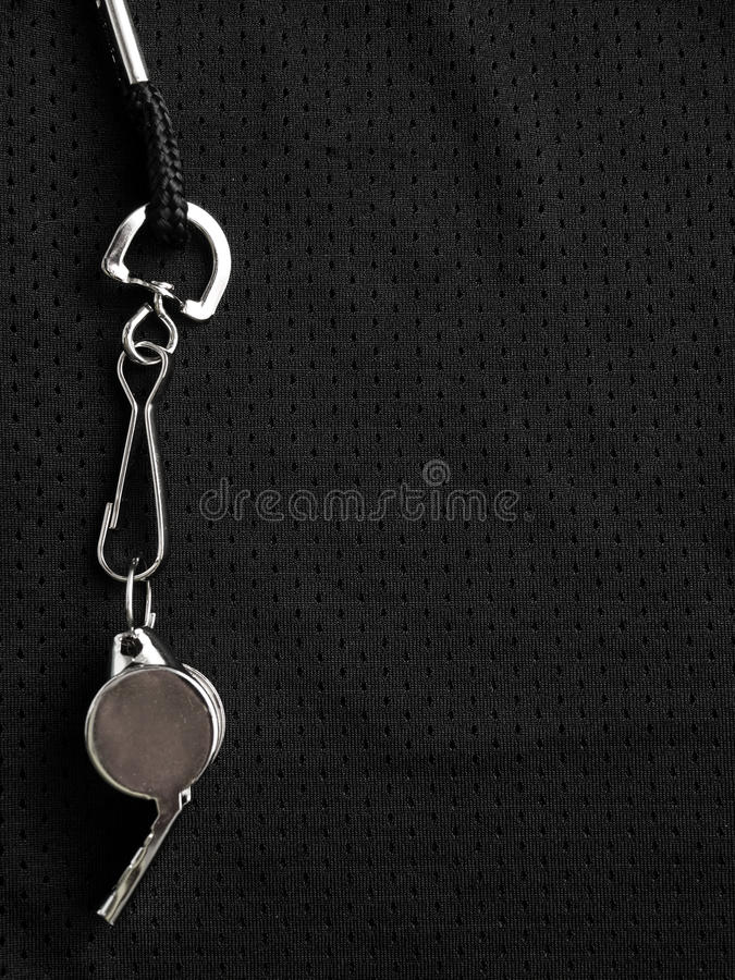 Referee whistle. On black sports background royalty free stock images