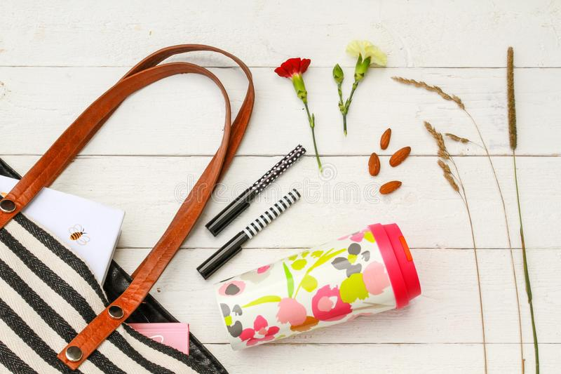 Refillable coffee mug and purse accessories stock photo