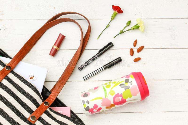 Refillable coffee mug and purse accessories royalty free stock photography