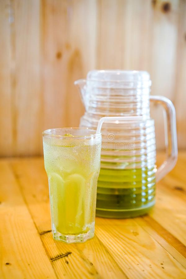 Refillable Japanese greentea in the glass on the table at the restaurant royalty free stock images