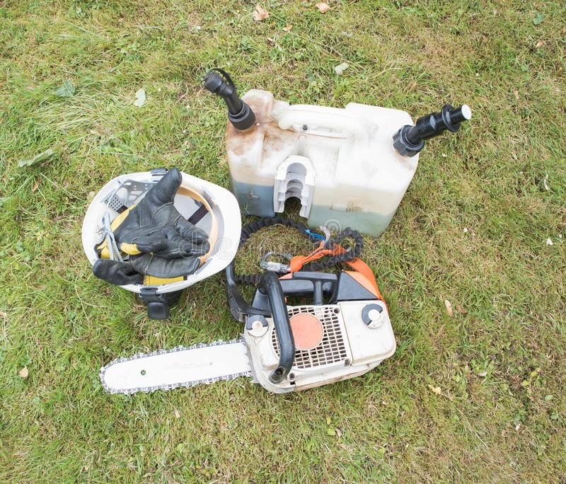 Refilled Chainsaw and equipment royalty free stock photos