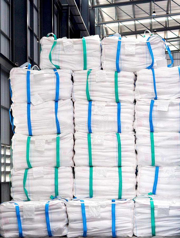Refine sugar in white jumbo bag stack inside warehouse. Stack of refine sugar bag pack in big jumbo bag store inside a distribution warehouse waiting for export royalty free stock image