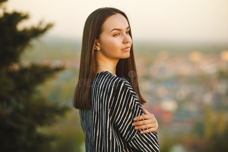 Refined look cute and beautiful girls. portrait of young woman at sunset. royalty free stock image