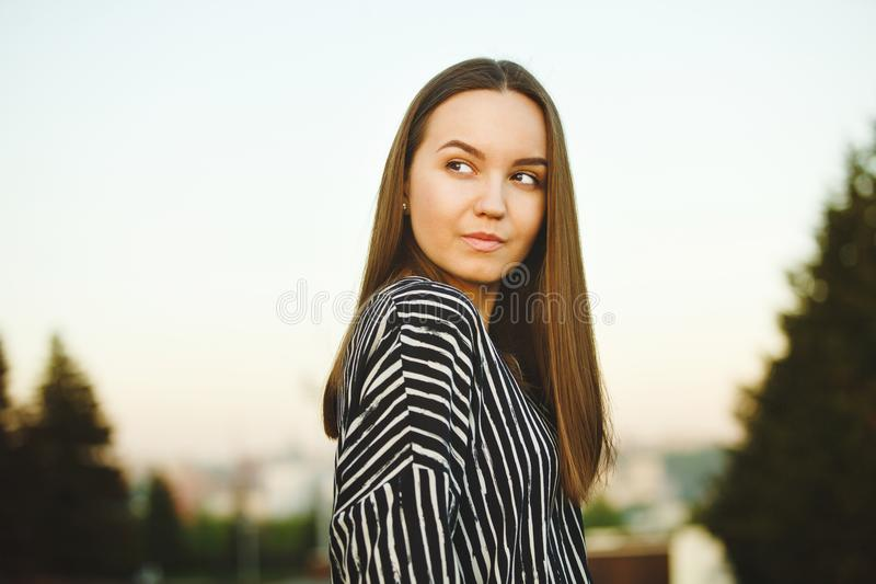 Refined look cute and beautiful girls. portrait of young woman at sunset. stock images
