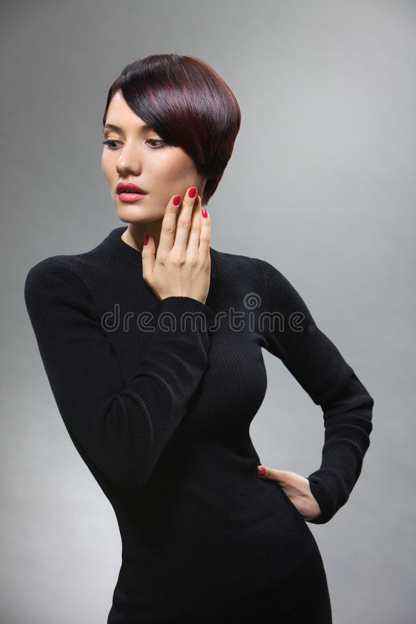 Refined slim model in an elegant pose royalty free stock photography