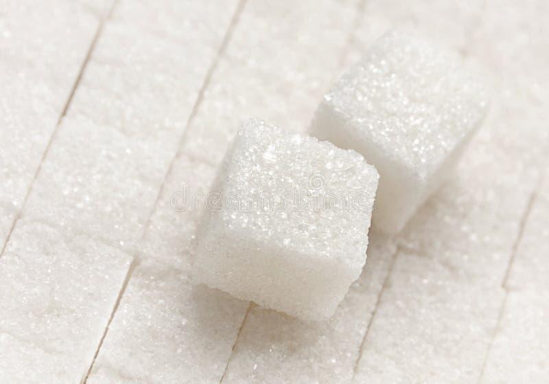 Refined sugar cube closeup. Sweet food refined white sugar cube closeup stock images