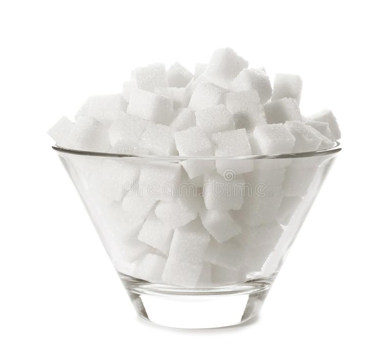 Refined sugar cubes in bowl. On white background royalty free stock photos