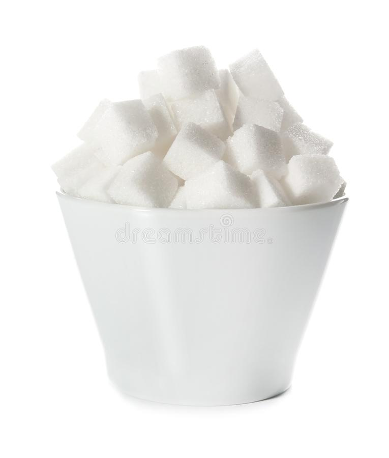 Refined sugar cubes in bowl. On white background stock images