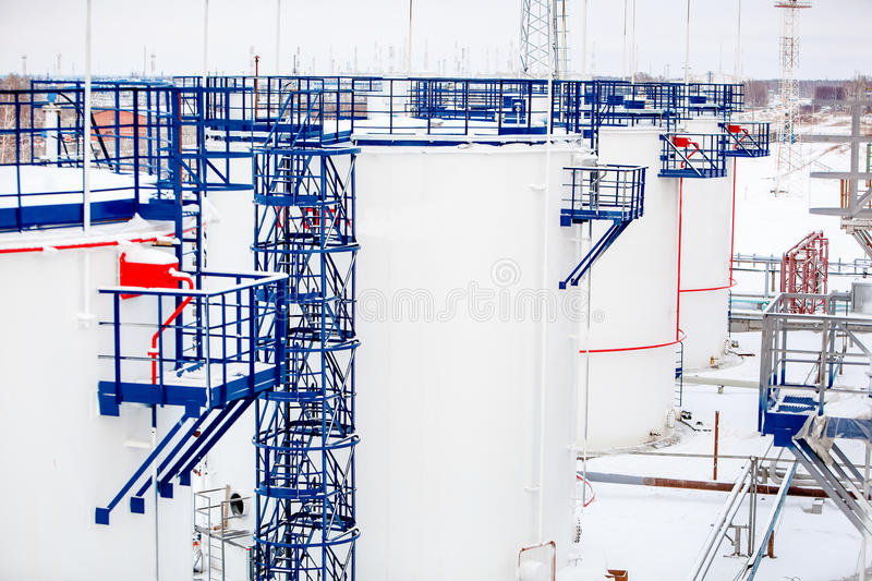Refinery factory oil storage tanks close up. Refinery factory oil storage tanks outside at winter close up royalty free stock images