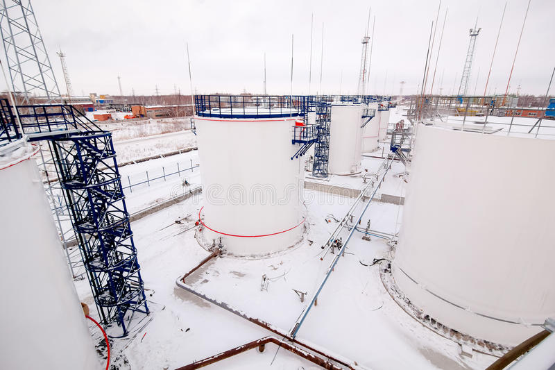 Refinery factory oil storage tanks. Outside at winter royalty free stock photography