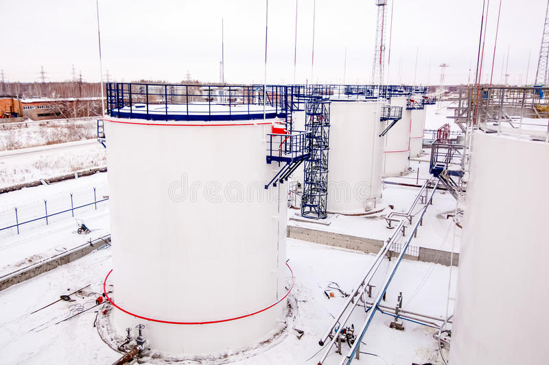 Refinery factory oil storage tanks. Outside at winter royalty free stock photos