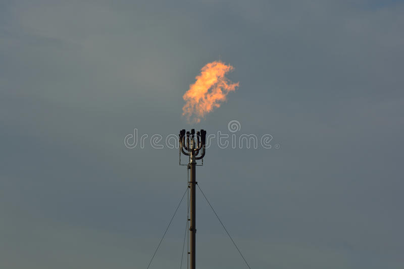 Refinery Flare Smokestack Burning Natural Gas royalty free stock photo