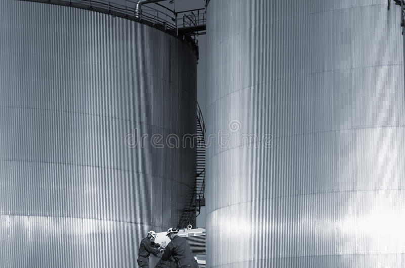 Download Refinery Fuel- Towers And Engineers Stock Photo - Image of industry, gasoline: 22666246