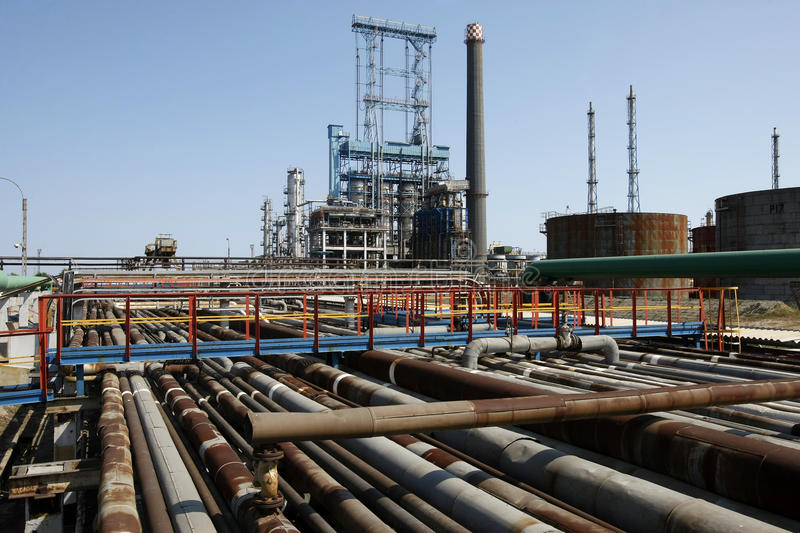 Refinery oil pipes. Industrial view of oil petrochemical refinery pipes stock images