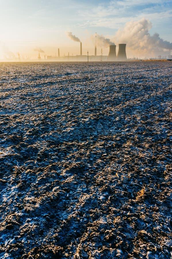 Refinery over frozen field stock photos