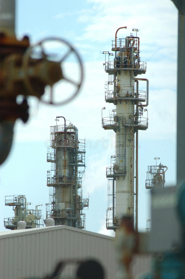 Refinery. Unidentified men work at the top of a tower at the BP oil refinery near the mouth of the Brisbane River, September 28, 2008, Brisbane, Australia royalty free stock images