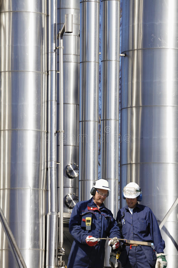Download Refinery Workers And Pipelines Stock Photo - Image: 23559964