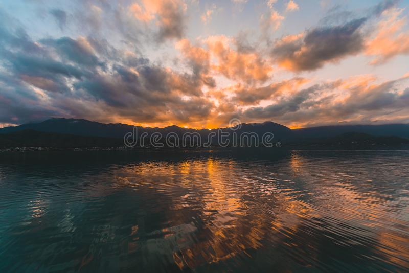 Reflect Photography of Body of Water Near Island stock image