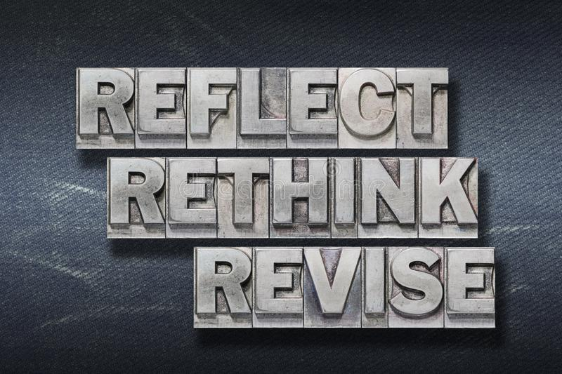 Reflect, rethink den. Reflect rethink revise words made from metallic letterpress on dark jeans background stock photos