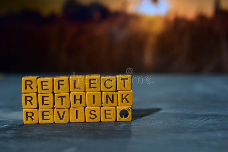 Reflect - Rethink - Revise on wooden blocks. Cross processed image with bokeh background stock photo
