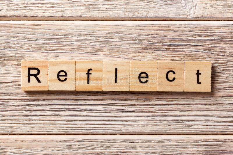Reflect word written on wood block. Reflect text on table, concept.  stock photography