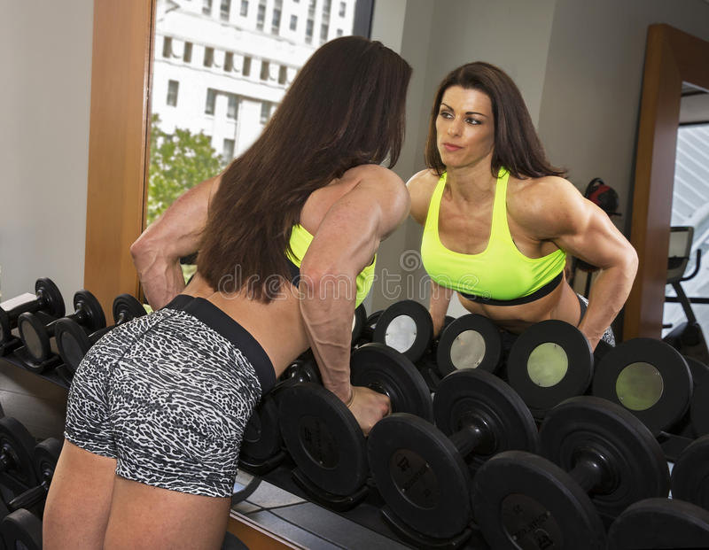 Reflected Beauty in the Gym stock images