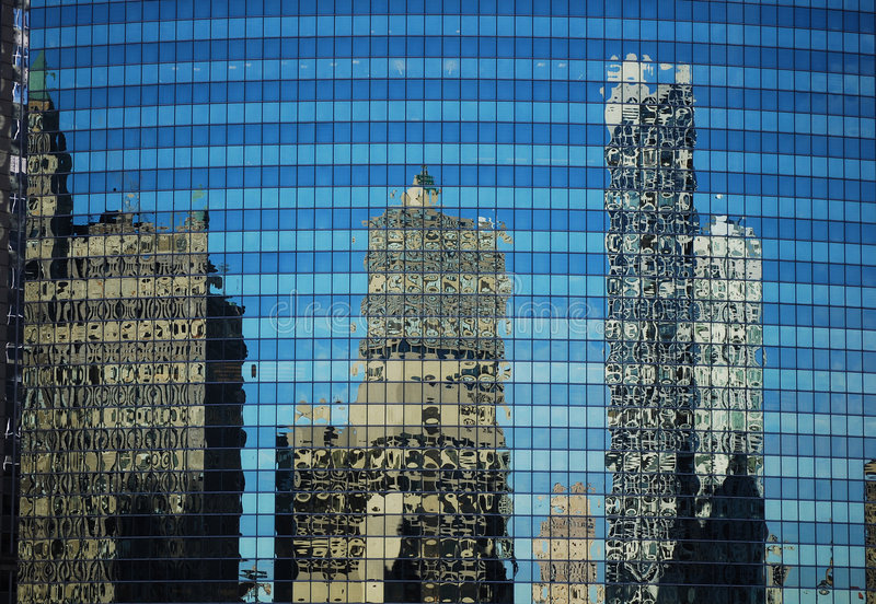 Reflected buildings royalty free stock photos