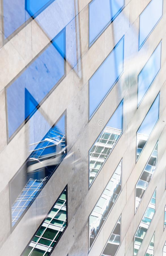 Reflected buildings double exposure. Double exposure architectural abstract. Detail of windows and reflections with focus on reflected buildings stock image