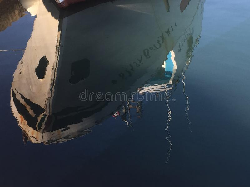 Reflected image - ship in the port stock image