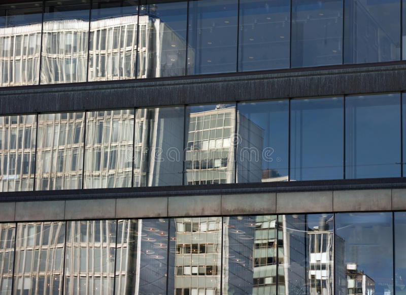 Reflected office buildings stock image