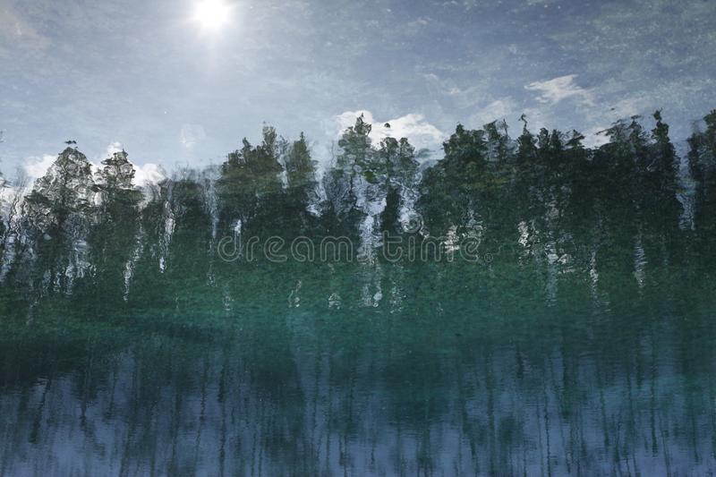 Reflected in the water with ripples landscape, forest, sky stock photos