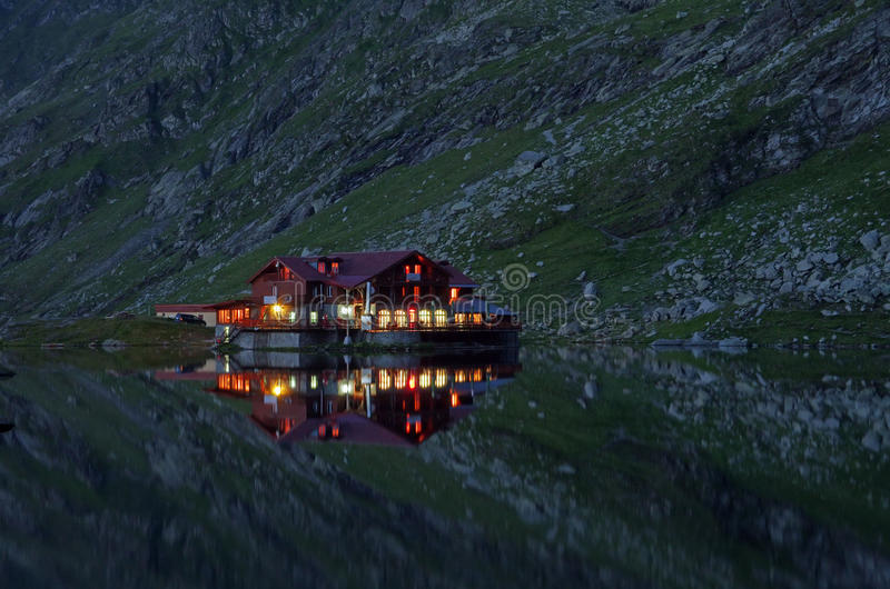 Reflecting chalet royalty free stock photography