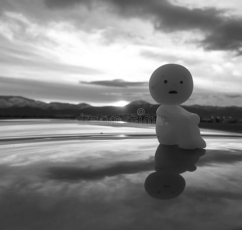 Reflecting figurine stock photo