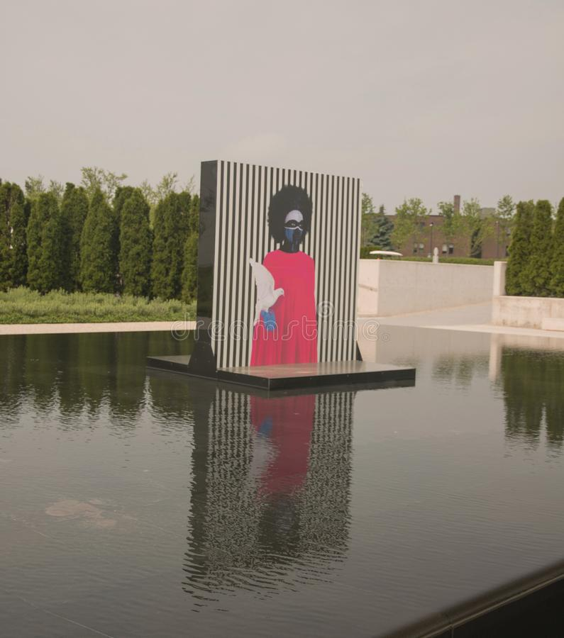 Aga Khan Museum In Toronto. The reflecting pools in the Aga Khan Museum transformed into an exhibition venue. It presents large-scale portraits by ethiopian stock photography