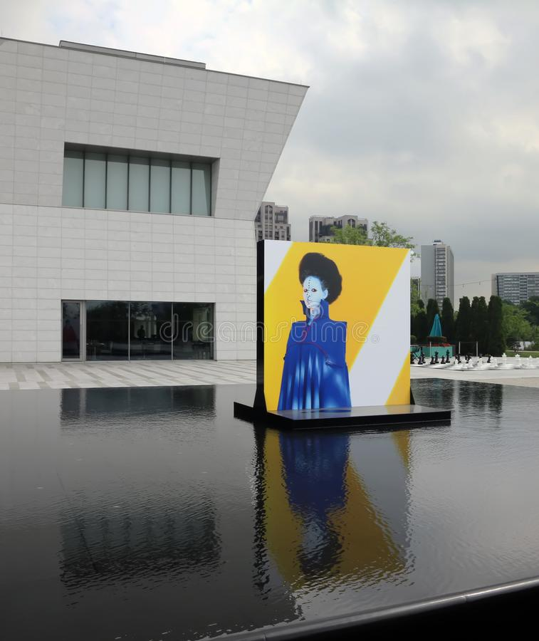Aga Khan Museum In Toronto. The reflecting pools in the Aga Khan Museum transformed into an exhibition venue. It presents large-scale portraits of women by royalty free stock photos